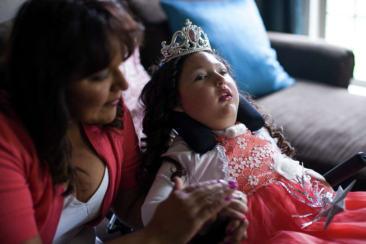 Victoria Ammann talks to her daughter Emily, 6, while getting ready to attend an ice skating show Friday April 3, 2015. Emily has suffered from seizures since nine weeks old, and her brain is in a constant state of seizing. The non-euphoric cannabidiol oil has proven to treat intractable seizures, and Victoria hopes with the passing of the Texas Compassionate Use Act, House Bill 892 and Senate Bill 339, that Emily can soon receive the same help.