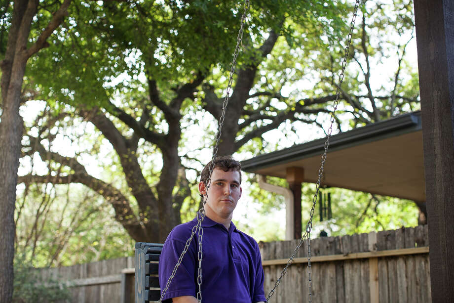 Zachariah Moccia, 24, swings in his backyard Friday April 3, 2015. Zach started having seizures at the age of two months, and is diagnosed with Dravet Syndrome. The non-euphoric cannabidiol oil has proven to treat intractable seizures, and Leslie hopes with the passing of the Texas Compassionate Use Act, House Bill 892 and Senate Bill 339, that Zach can soon receive the same help. Photo: Julysa Sosa / Julysa Sosa For the San Antonio Express-News