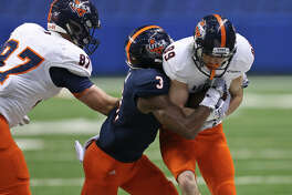 UTSA White Team's Miles Lerch is hit by UTSA Blue Team's Stanley Dye Jr. as UTSA White Team's Trevor Stevens moves in on the play during their Football Fiesta Spring Game held Saturday April 18, 2015 at the Alamodome. UTSA White Team won 57-42.