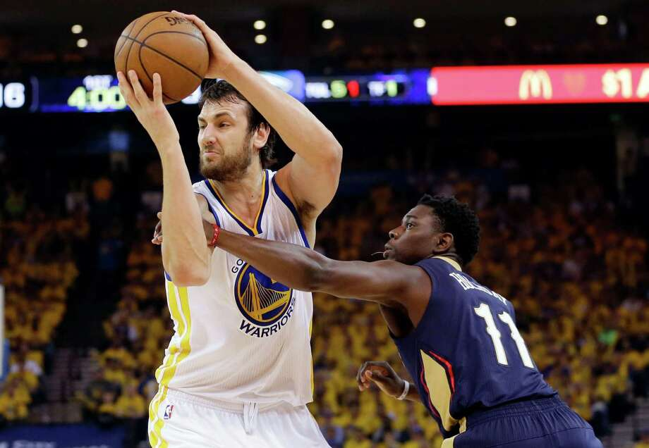 Warriors Andrew Bogut (12), who missed last season's playoffs because of a broken rib, grabs one of his 14 rebounds while having an excellent outing against the Pelicans in Game 1. Photo: Marcio Jose Sanchez / Associated Press / AP