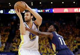 Warriors Andrew Bogut (12), who missed last season's playoffs because of a broken rib, grabs one of his 14 rebounds while having an excellent outing against the Pelicans in Game 1.