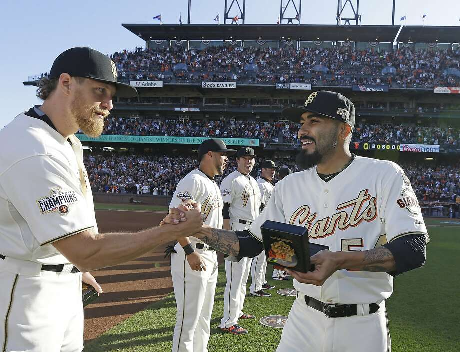 San Francisco Giants' Hunter Pence, left, shakes hands with Sergio Romo during the 2014 World Series championship ring ceremony before the Giants' baseball game against the Arizona Diamondbacks on Saturday, April 18, 2015, in San Francisco. (AP Photo/Ben Margot, Pool) Photo: Ben Margot, Associated Press