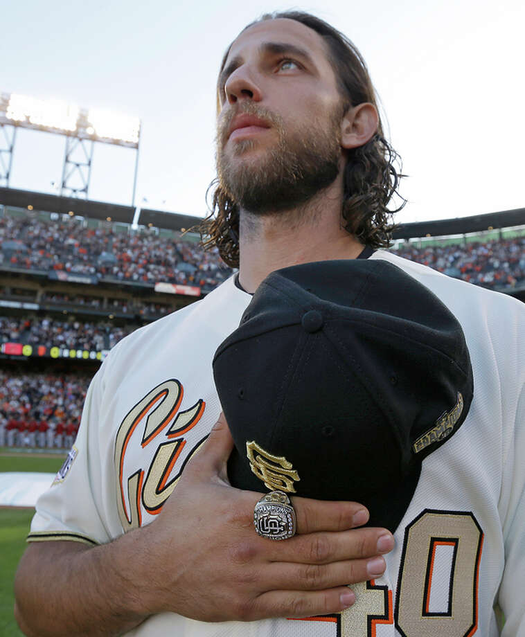 Madison Bumgarner stands for the national anthem, new ring on finger. Photo: Ben Margot / Associated Press / POOL AP