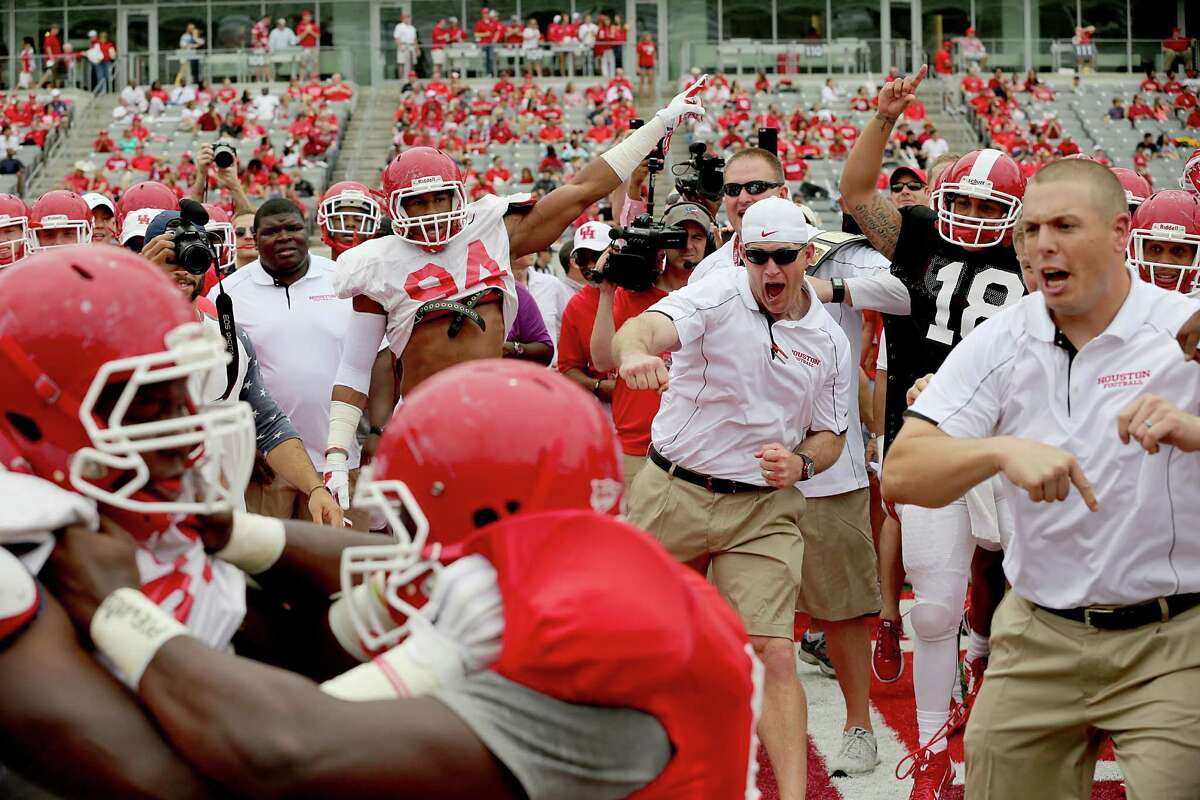 Coaches and players cheer on circle drill match competitors before in the Spring Red and White game on April 18, 2015 at UH's TDECU Stadium in Houston, TX. White won 24 to 11.