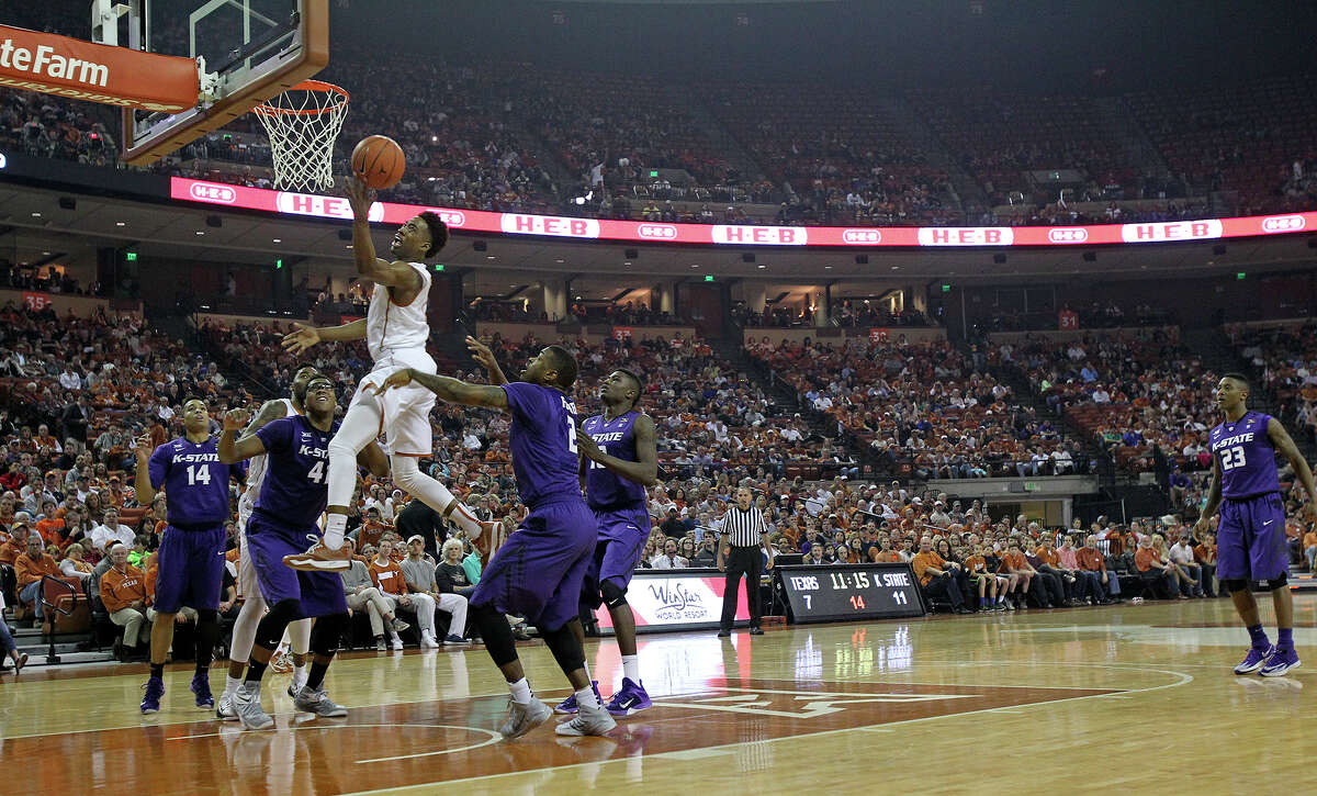 The signs in the background at the Erwin Center indicate that San Antonio-based grocer H-E-B in a major sponsor at UT.