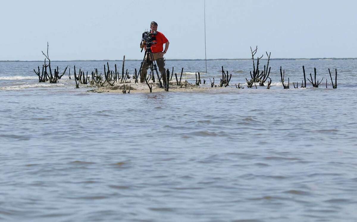 Little life remains for a cameraman to document on Cat Island in Louisiana's as erosion since the oil spill five years ago is making the tiny isle even smaller.