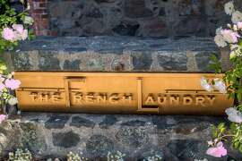 The sign on the from of the building at the French Laundry in Yountville, Calif., is seen on April 17th, 2015.