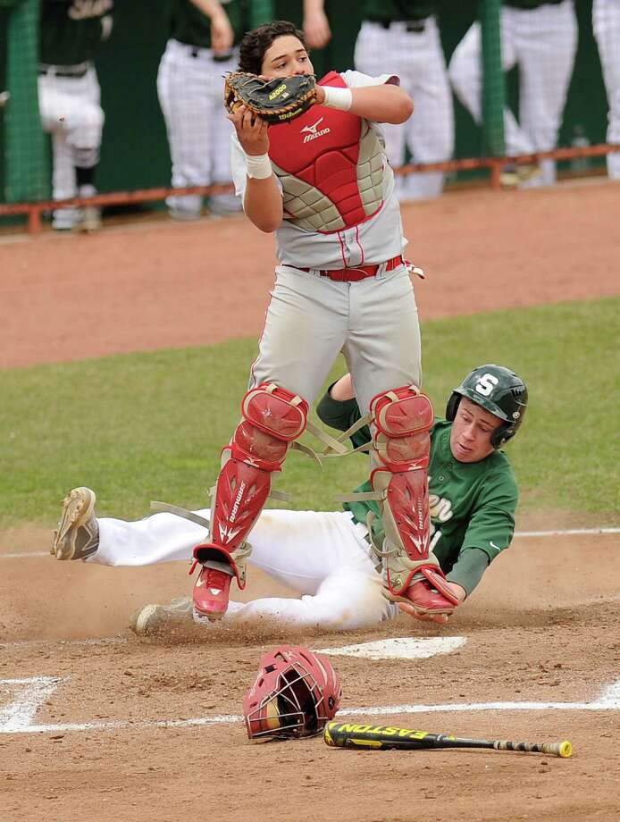 Shenendehowa's Brad Pearson slides safely into home plate under North Rockland catcher Ivan Rodigues during the second inning of their High School Baseball game at Joseph L. Bruno Stadium in Troy, N.Y., Saturday, April 18, 2015. (Hans Pennink / Special to the Times Union) ORG XMIT: HP101 Photo: Hans Pennink / 00031477A