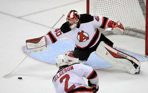 Albany Devils' goalie #40 Scott Clemmensen reels in the puck during Saturday's game against the Hartford Wolfpack at the Times Union Center April 18, 2015 in Albany, NY.  (John Carl D'Annibale / Times Union) Photo: John Carl D'Annibale / 00030124T