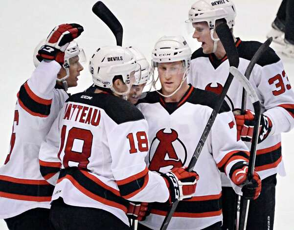 Albany Devils' #7 Brandon Burlon, center, is congratulated by team mates after his goal during Saturday's game against the Hartford Wolfpack at the Times Union Center April 18, 2015 in Albany, NY.  (John Carl D'Annibale / Times Union) Photo: John Carl D'Annibale / 00030124T