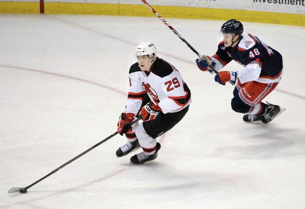 Albany Devils' #29 Raman Hrabarenka, left, skates away from Hartford Wolfpack's #48 Carl Klingberg during Saturday's game at the Times Union Center April 18, 2015 in Albany, NY.  (John Carl D'Annibale / Times Union) Photo: John Carl D'Annibale / 00030124T