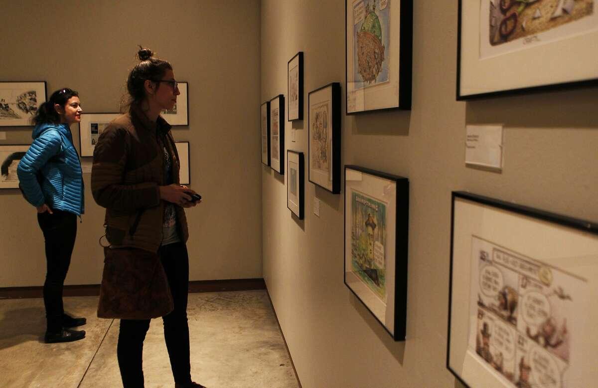 Shirley Skorbiansky (left) and Sharon Raszap-Skorbiansky look at illustrations in the