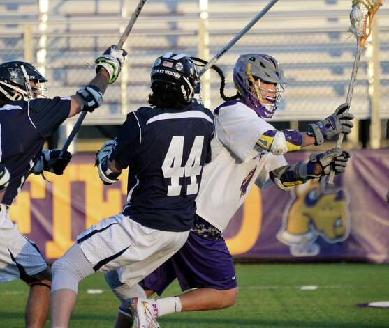 UAlbany's #4 Lyle Thompson, right, drives through Yale defenders to score during Saturday's lacrosse game April 18, 2015 in Albany, NY.  (John Carl D'Annibale / Times Union) Photo: John Carl D'Annibale / 00031486A