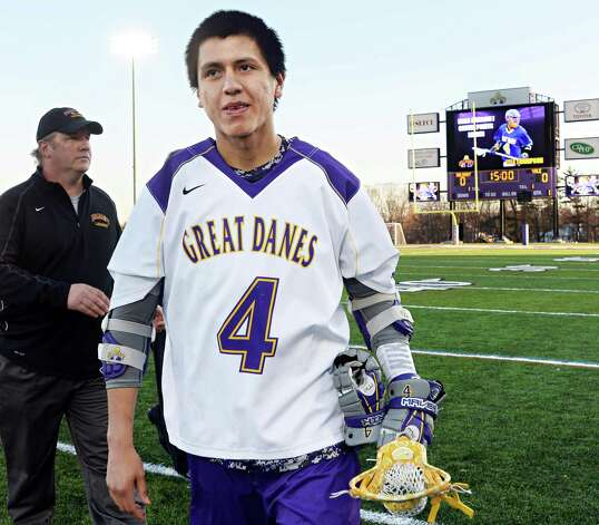 UAlbany's #4 Lyle Thompsonis honored in a ceremony before Saturday's lacrosse game against Yale April 18, 2015 in Albany, NY.  (John Carl D'Annibale / Times Union) Photo: John Carl D'Annibale / 00031486A