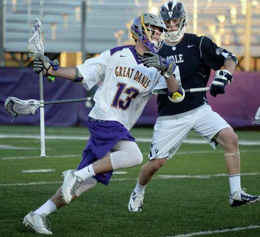 UAlbany's #Tim Cox, left, and Yale's #1 Reilly Naton during Saturday's lacrosse game April 18, 2015 in Albany, NY.  (John Carl D'Annibale / Times Union) Photo: John Carl D'Annibale / 00031486A