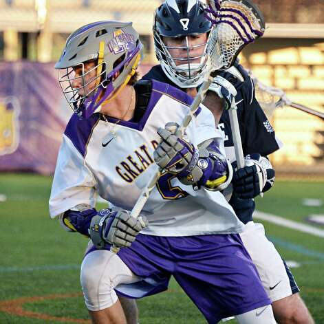 UAlbany's #5 Connor Fields, left, spins past Yale's #16 Mark Glicini during Saturday's lacrosse game April 18, 2015 in Albany, NY.  (John Carl D'Annibale / Times Union) Photo: John Carl D'Annibale / 00031486A