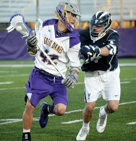 UAlbany's #42 Ky Tarbell, left, and Yale's #45 Jason Alessi tangle during Saturday's lacrosse game April 18, 2015 in Albany, NY.  (John Carl D'Annibale / Times Union) Photo: John Carl D'Annibale / 00031486A