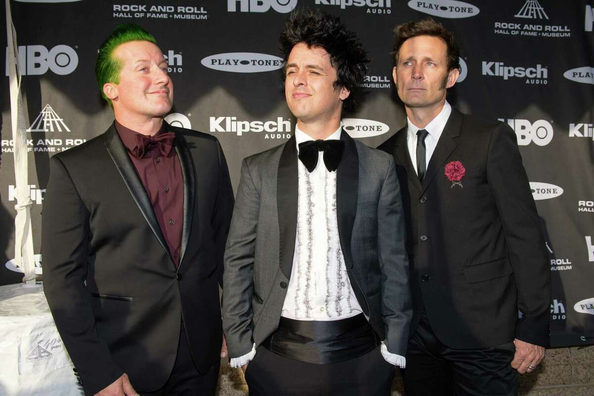 The members of the band Green Day prior to the 2015 Rock And Roll Hall Of Fame Induction Ceremony at Public Hall on Saturday, April 18, 2015, in Cleveland, Ohio. (Photo by Jason Miller/Invision/AP)