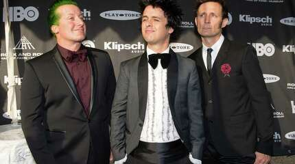 The members of the band Green Day prior to the 2015 Rock And Roll Hall Of Fame Induction Ceremony at Public Hall on Saturday, April 18, 2015, in Cleveland, Ohio. (Photo by Jason Miller/Invision/AP) ORG XMIT: OHJM110