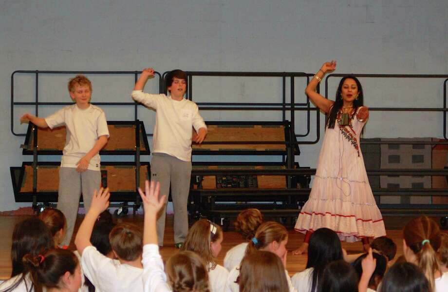 Students try belly dancing on India Day. Photo: Contributed Photo / Darien News
