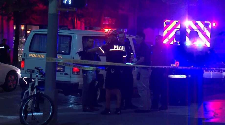 Police investigate the scene of a Sunday morning  assault downtown. Photo: Screen Grab