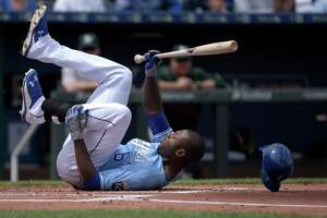 KANSAS CITY, MO - APRIL 19:  Lorenzo Cain #6 of the Kansas City Royals falls to the ground after being hit by a pitch in the first inning during a game against the Oakland Athletics on April 19, 2015 at Kauffman Stadium in Kansas City, Missouri. (Photo by Ed Zurga/Getty Images)