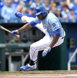 Kansas City Royals' Lorenzo Cain (6) is hit by a pitch from Oakland Athletics starting pitcher Scott Kazmir (26) during the first inning on Sunday, April 19, 2015, at Kauffman Stadium in Kansas City, Mo. (John Sleezer/Kansas City Star/TNS)