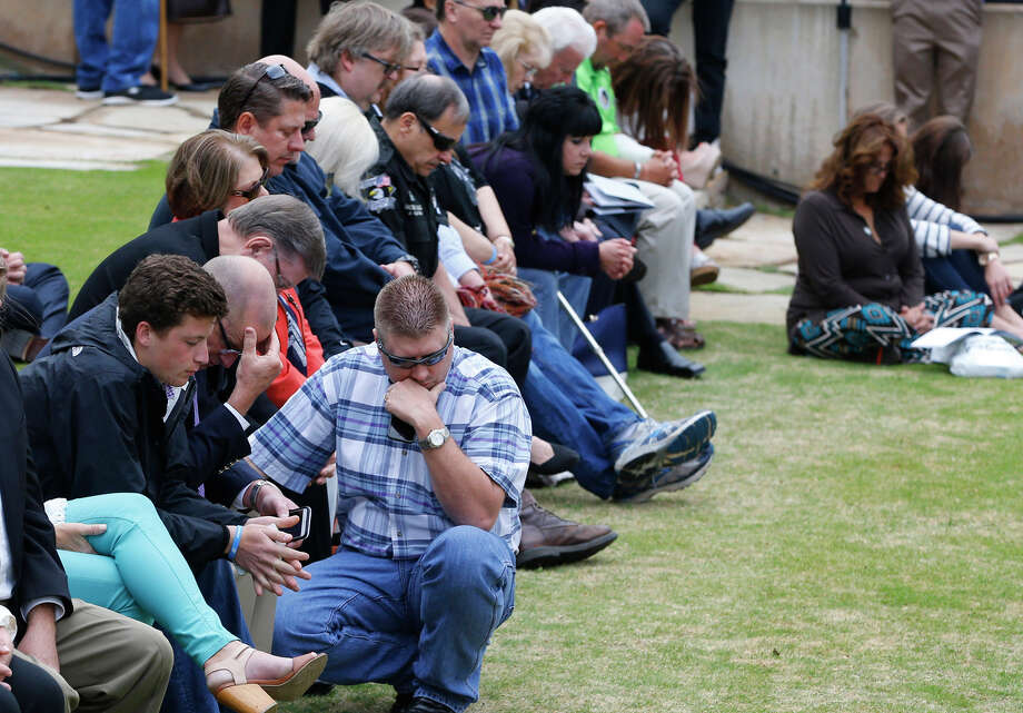Heads are bowed during a moment of prayer during a ceremony to commemorate the 20th anniversary of the Oklahoma City Murrah Building bombing that killed 168 people. Photo: Sue Ogrocki / Associated Press / AP