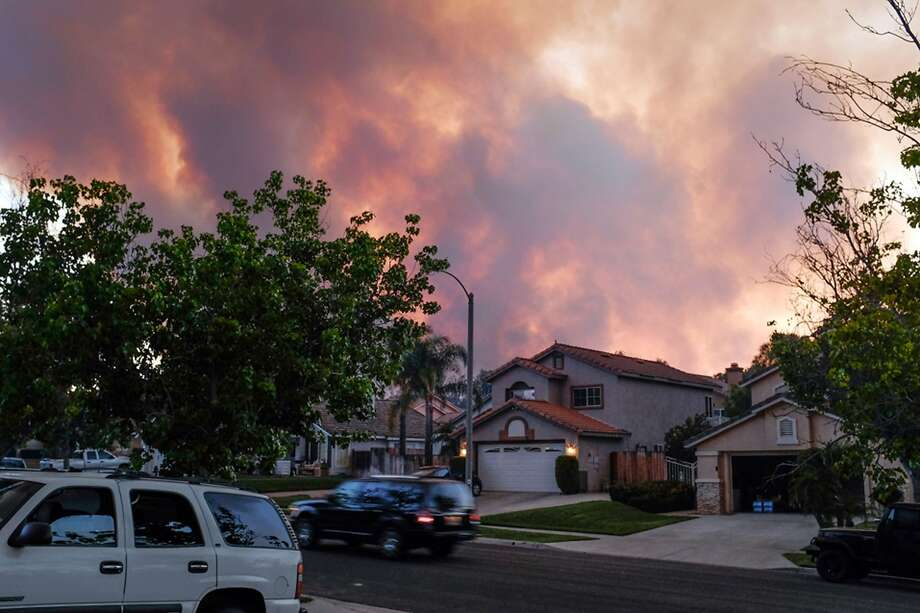 Though still plagued by drought and wildfires (smoke fills the Corona sky last week), the Inland Empire is on its way back economically. Photo: Sal Guerra, Associated Press