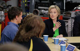 Hillary Clinton, shown in Monticello, Iowa, is courting more liberal voters with altered positions.
