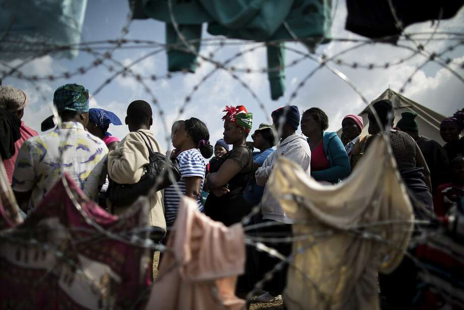 """TOPSHOTS Displaced people who fled the anti-immigrant violence are seen in a camp on April 19, 2015 in the village of Primrose, 15 kms east of Johannesburg. The government stepped up on April 19 its response to unrest in Johannesburg and the eastern coastal city of Durban, with Home Minister Malusi Gigaba resolving to end """"all acts that seek to plunge our country into anarchy"""". AFP PHOTO/MARCO LONGARIMARCO LONGARI/AFP/Getty Images Photo: Marco Longari, AFP / Getty Images"""