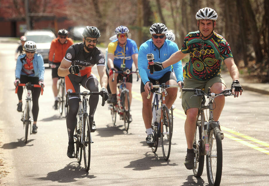 Cyclists make their way down Burroughs Road in Fairfield, Conn. during the Library to Library Bike Tour to kick off the town's Earth Day Celebration on Sunday, April 19, 2015. Cyclists rode a 8.5 mile round trip route linking the Fairfield Public Library to the Fairfield Woods Branch Library on Fairfield Woods Road. Photo: Brian A. Pounds / Connecticut Post