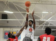 St. Thomas More's Steve Enoch, of Norwalk, who will play for UCONN, shoots over a New Jersey defender during the 54th Annual Schoolboy All-Star Classic basketball game at the Cardinal Sheehan Center in Bridgeport, Conn. on Sunday, April 19, 2015.
