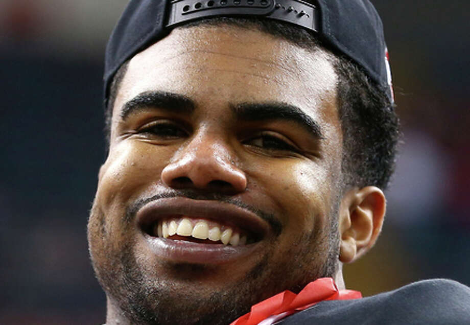 NEW ORLEANS, LA - JANUARY 01:  Ezekiel Elliott #15 of the Ohio State Buckeyes celebrates with the trophy after defeating the Alabama Crimson Tide in the All State Sugar Bowl at the Mercedes-Benz Superdome on January 1, 2015 in New Orleans, Louisiana.  The Ohio State Buckeyes defeated the Alabama Crimson Tide 42 to 35.  (Photo by Streeter Lecka/Getty Images) Photo: Streeter Lecka / Getty Images / 2015 Getty Images
