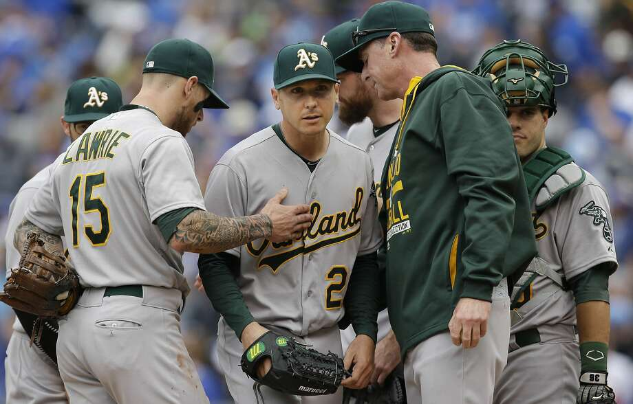 Oakland Athletics starting pitcher Scott Kazmir, center, is taken from a baseball game by manager Bob Melvin, second from right, during the eighth inning against the Kansas City Royals at Kauffman Stadium in Kansas City, Mo., Sunday, April 19, 2015. (AP Photo/Orlin Wagner) Photo: Orlin Wagner, Associated Press