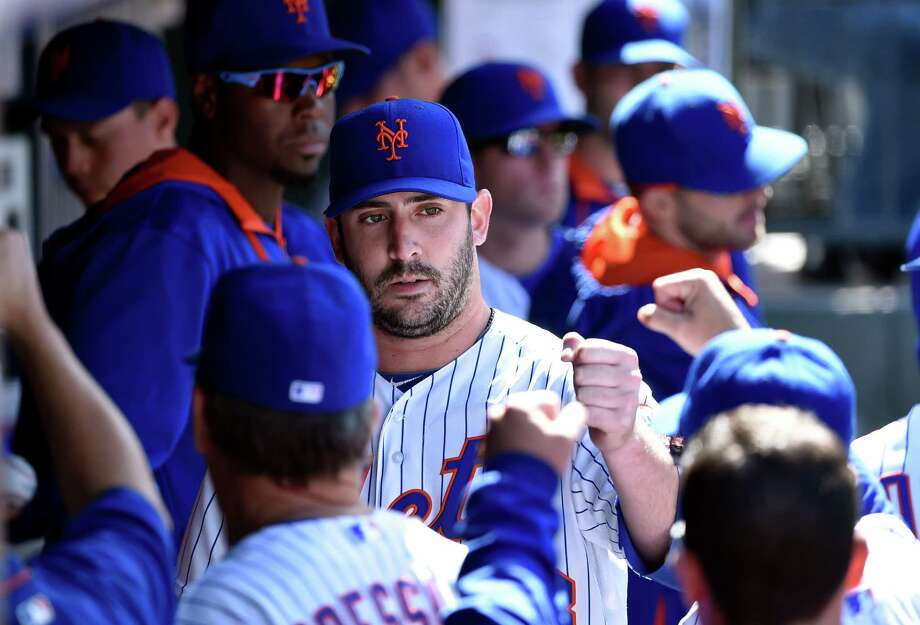 New York Mets starting pitcher Matt Harvey celebrates with teammates in the dugout after pitching seven innings against the Miami Marlins in a baseball game at Citi Field on Sunday, April 19, 2015, in New York. (AP Photo/Kathy Kmonicek) ORG XMIT: NYM109 Photo: Kathy Kmonicek / FR170189 AP