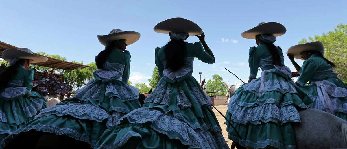 Members of the Escaramuza Las Potrancas take part in the opening ceremony of the Day in Old Mexico and Charreada event Sunday April 19, 2015 at the San Antonio Charro Ranch.