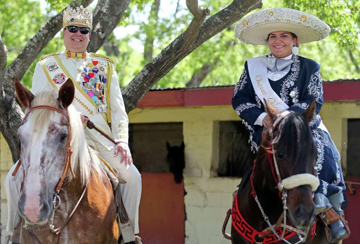 Portrait of El Rey Feo LXVII Jon Gary Herrera (left) and Charro Queen Yazmin Bernal, 17, before the Day in Old Mexico and Charreada Sunday April 19, 2015 at the San Antonio Charro Ranch.