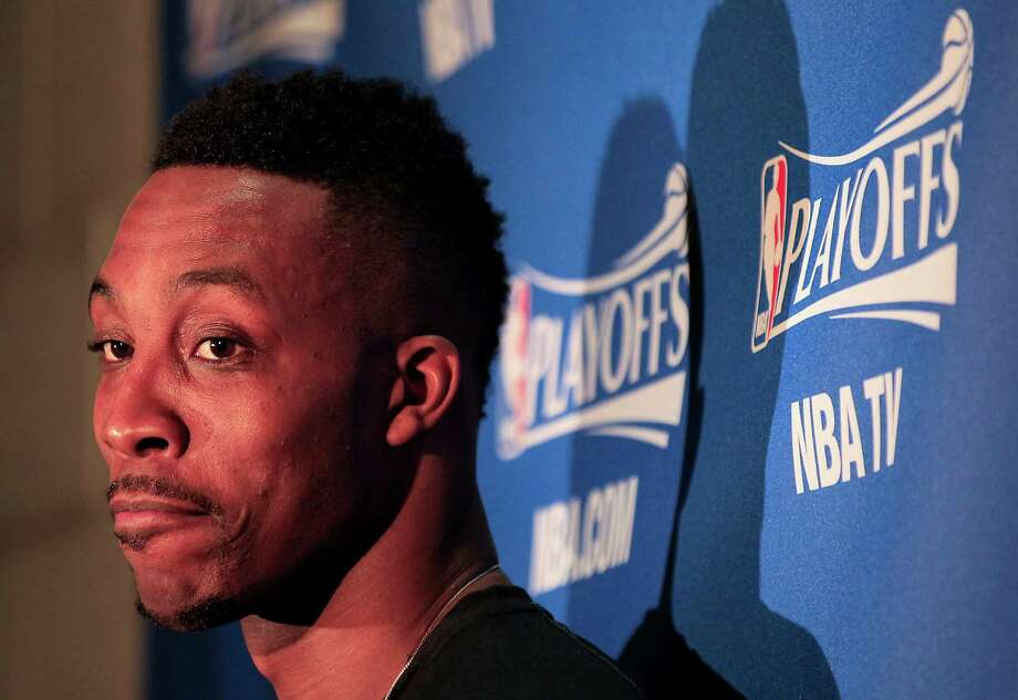 Foul trouble limited Rockets center Dwight Howard in Saturday's win, but he vows to remain aggressive on defense against the Mavs in the first-round series. Photo: James Nielsen, Staff / © 2015  Houston Chronicle