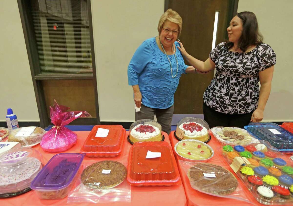 Rita Ashby, left, jokes with Brenda Hailey at the dessert auction during a lunch after the Sunday service on April 12 at Clay Road Baptist Church. The auction helped raise funds for children to attend a summer camp.