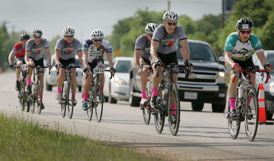 Though the planned Houston-to-La Grange leg of the MS 150 on Saturday was cancelled because of thunderstorms and flooding, cyclists rode the La Grange-to-Austin leg Sunday under blue skies. Photo: Ralph Barrera / AustinStatesman
