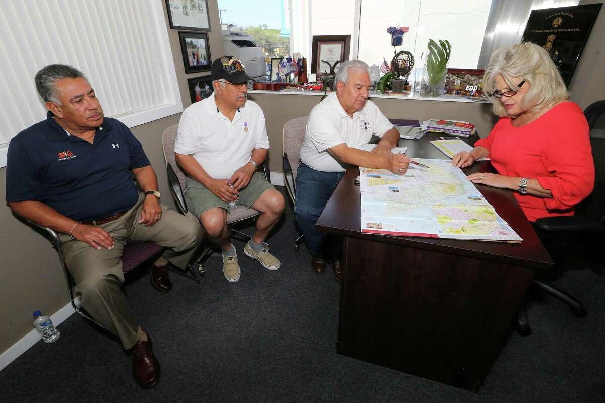 Vietnam War veterans Tony Fuentes (from left), Lorenzo Rodriguez and Manuel Soto talk with Janis Roznowski about their February trip back to Vietnam. Roznowski is the founder and executive director of Operation Comfort.