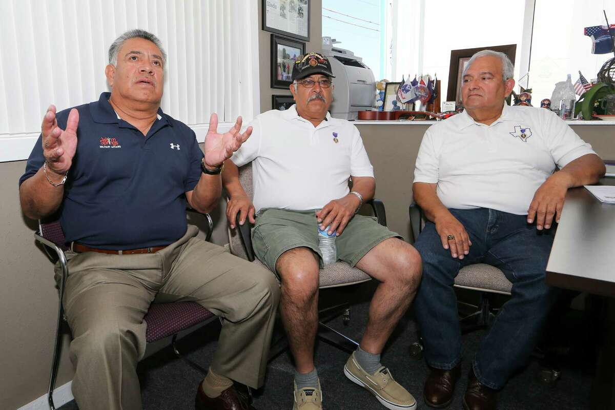 Tony Fuentes (from left), Lorenzo Rodriguez and Manuel Soto speak of their recent trip back to Vietnam at Operation Comfort, 4900 Broadway, Ste. 100, on Tuesday, March 24, 2015. The three Vietnam veterans were part of of group of eleven sponsored by Operation Comfort that toured the country this past February. MARVIN PFEIFFER/ mpfeiffer@express-news.net