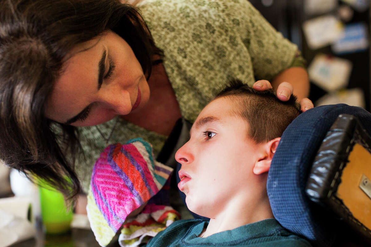 Liz Tullis doesn't want to have to move her son Conrad, 12, away from their family and support system they have established in Texas to a state like Colorado where she could legally obtain CBD oil to treat his debilitating seizures.
