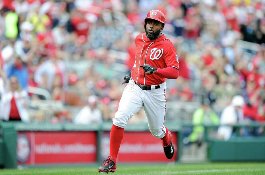 WASHINGTON, DC - APRIL 19:  Denard Span #2 of the Washington Nationals rounds third base and scores in the fifth inning against the Philadelphia Phillies at Nationals Park on April 19, 2015 in Washington, DC.  Washington won the game 4-1. (Photo by Greg Fiume/Getty Images) ORG XMIT: 538577735 Photo: Greg Fiume / 2015 Getty Images