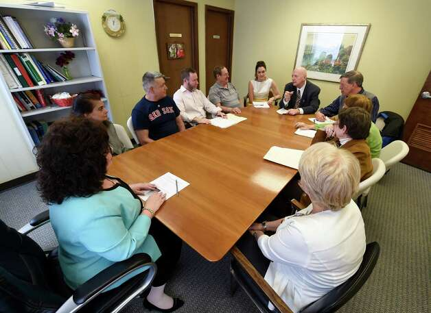 Board president Brian Barr, center background,  speaks to members of the staff and clients at Senior Hope Thursday morning April 16, 2015 in Albany, N.Y. (Skip Dickstein/Times Union) Photo: SKIP DICKSTEIN / 00031473A