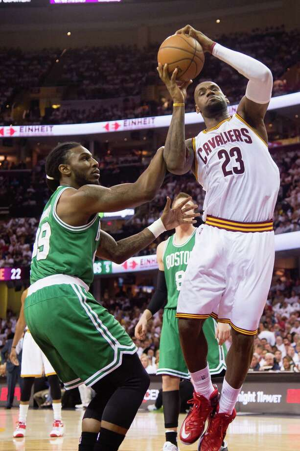 CLEVELAND, OH - APRIL 19: Jae Crowder #99 of the Boston Celtics fouls LeBron James #23 of the Cleveland Cavaliers in the first half during Game One in the Eastern Conference Quarterfinals of the 2015 NBA Playoffs 2015 at Quicken Loans Arena on April 19, 2015 in Cleveland, Ohio. NOTE TO USER: User expressly acknowledges and agrees that, by downloading and or using this photograph, User is consenting to the terms and conditions of the Getty Images License Agreement. (Photo by Jason Miller/Getty Images) ORG XMIT: 548979397 Photo: Jason Miller / 2015 Getty Images