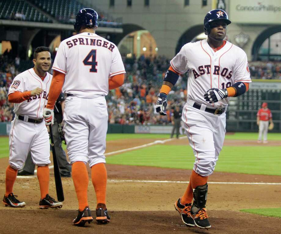 Luis Valbuena, right, completes his trip around the bases after becoming the first Astro to hit three homers this season, with the third-inning blast also scoring Jose Altuve, left. Photo: Melissa Phillip, Staff / © 2015  Houston Chronicle