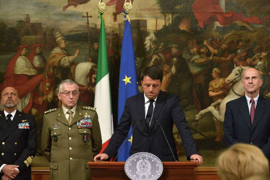 """Italian Prime Minister Matteo Renzi gives a press conference focused on the shipwreck of migrants last night off the Libyan coast, on April 19, 2015 in Rome. Prime Minister Matteo Renzi said Rome would be seeking the extraordinary meeting after up to 700 people were feared to have drowned when a boat carrying them towards Italy capsized off Libya. """"We are working to ensure this meeting can be held by the end of the week. It has to be a priority,"""" Renzi told a press conference.  AFP PHOTO / TIZIANA FABITIZIANA FABI/AFP/Getty Images Photo: TIZIANA FABI / AFP"""