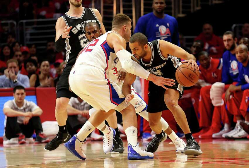 LOS ANGELES, CA - APRIL 19: Tony Parker #9 of the San Antonio Spurs drives against Blake Griffin #32 and Chris Paul #3 of the Los Angeles Clippers during Game One of the Western Conference quarterfinals of the 2015 NBA Playoffs at Staples Center on April 19, 2015 in Los Angeles, California. NOTE TO USER: User expressly acknowledges and agrees that, by downloading and or using this photograph, User is consenting to the terms and conditions of the Getty Images License Agreement.